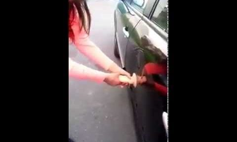 Girl fixes dent in car with sex toy (NSFW)